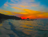 Small boats at the Andaman Sea in sunset Stock Images