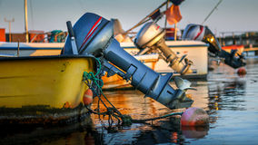 Small boats with attached outboard motors in harbor Royalty Free Stock Photography