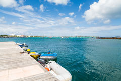 Small Boats in Azure Water Under Blue Sky Royalty Free Stock Images