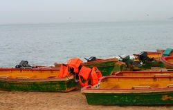 Small boats on beach. Small, outboard motor boats on a sandy beach Stock Photo