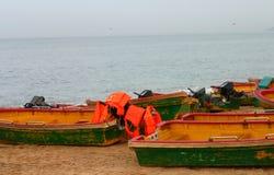 Small boats on beach Stock Photo