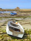 Small boats on beach at low tide. Small boats on the beach at Periglis Cove on the island of Saint Agnes in the Isles of Scilly in Cornwall, England stock photography