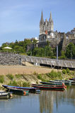 Small boats and Cathedral of Angers in France Stock Photo