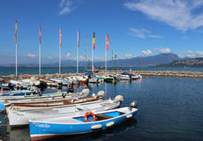 Small boats in Cisano harbor, Lake Garda, Italy Stock Photo