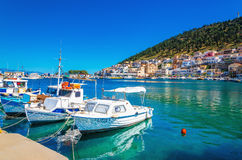 Small boats in cozy port of Pothia, Greece Stock Photography