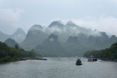 Small boats and the cruise ships on Li river in China Royalty Free Stock Photos