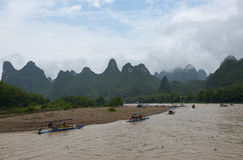 Small boats and the cruise ships on Li river in China Royalty Free Stock Photo