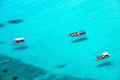 Small boats on the crystal clear sea Stock Images