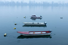 Small boats on the Danube on a foggy dusk in winter in Zemun, Belgrade, Serbia Stock Photo