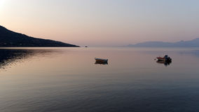 Small Boats at Dawn in Calm Bay Royalty Free Stock Photos