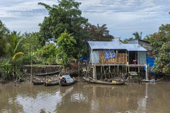 Small boats dock at a shack on stilts in the jungle. Royalty Free Stock Photography