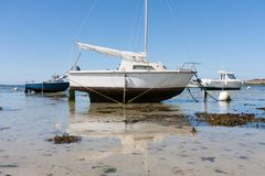 Small boats at ebb tide in Brittany, Franc Royalty Free Stock Photo