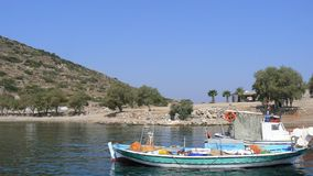 Small boats of fishermen on the sea of Turkey. Small boats of fishermen. Blue sky. Clear day. Sunny day. Summertime. Travel destination. Creek and coast. Holiday Royalty Free Stock Photo