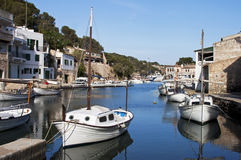 Small boats in a fishing village. Anchored small boats in a fishing village Stock Images