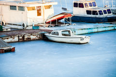 Small boats on frozen lake Royalty Free Stock Photography