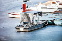 Small boats on frozen lake Stock Image