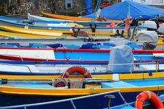 Small boats in harbor stock photo