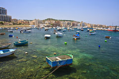 Small boats in harobur. A lot of small fishing boats in city of Bugibba, Malta Stock Photo