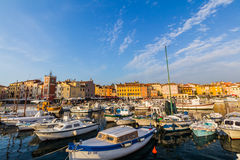 Small boats inside the harbor of an old Venetian town, Rovinj, Croatia Stock Image