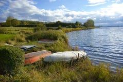 Small boats by a lake Royalty Free Stock Photo