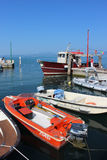 Small boats, Lake Garda Italy in Bardolino harbor Stock Photo