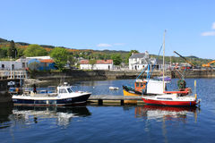 Small boats on Loch Gilp at Ardrishaig, Scotland. View of several small boats anchored at Ardrishaig in Loch Gilp (off Loch Fyne) by the entrance to the Crinan Stock Photos