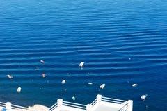 Small boats in the Mediterranean Sea off the island of Santorini Stock Photos