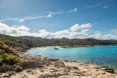 Boats in a small cove with sandy beach in Corsica Royalty Free Stock Photography
