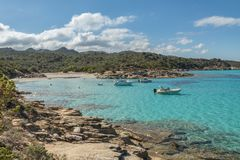 Boats in a small cove with sandy beach in Corsica Stock Image