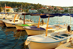 Small boats moored in the harbor of a town Postira - Croatia, island Brac Royalty Free Stock Photo