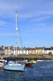 Small boats moored in Isle of Whithorn harbor. Stock Image
