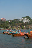 Small boats moored in ocean water Royalty Free Stock Images