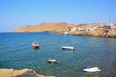 Small boats moored at Panormos, Crete. Small boats moored in the bay with views towards the rocky coastline, Panormos, Crete, Greece, Europe Stock Photos