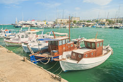 Small boats moored at port on sunny summer day Royalty Free Stock Photo