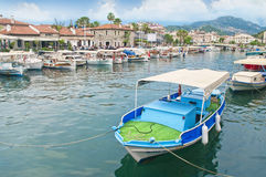 Small boats moored in sea canal with restaurants around Royalty Free Stock Photos