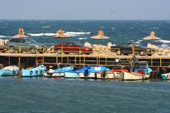 Small boats moored to a jetty Royalty Free Stock Images