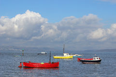 Small boats in Morecambe Bay at high tide. Stock Photo