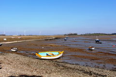 Small boats on mudflats at Sunderland Point, Lancs Royalty Free Stock Photography