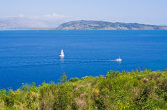 Small boats near the shore of Corfu island, Greece. Small boats near the shore of Corfu island - Greece Stock Image