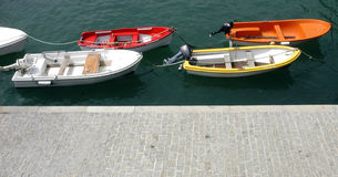 Small boats near walkway Royalty Free Stock Image