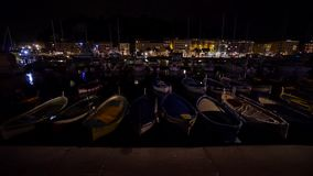 Small boats in the Nice port on night stock video footage