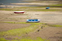Small Boats On Land Ground Stock Photo