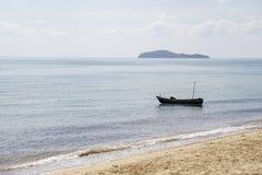 Small boats park by the sea. Small boats near the beach. Sandy beach at Sairee Beach, Chumphon Province