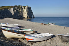 Small boats on pebble beach of Etretat in France Stock Image
