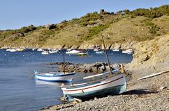 Small boats at Port Lligat in Spain Stock Photography