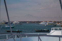 Small boats on read sea. Different boats, powerboats and ships on berth in Hurghada, Egypt Royalty Free Stock Photos