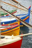 Colorful boats resting in the sea royalty free stock image