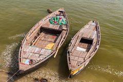 Small boats at river Ganges in Varanasi, Ind. Ia stock photo