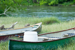 Small boats on riverbank Stock Photo