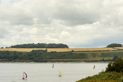 Small boats sailing in Falmouth fiord, Cornwall Royalty Free Stock Photography